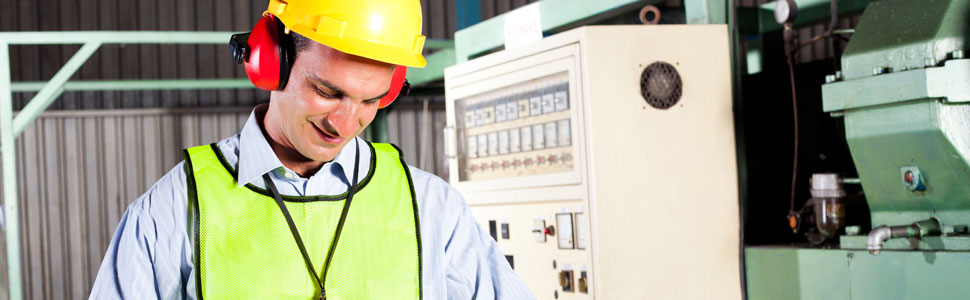 Industrial technician conducts health and safety check